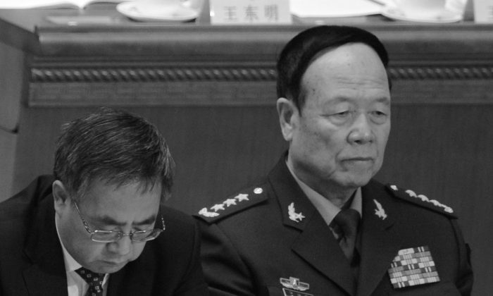 The Communist Party secretary of Guangdong province, Hu Chunhua (L), and Vice Chairman of the Central Military Commission Guo Boxiong. Guo may be the next target of the campaign against corruption in the military. (Goh Chai Hin/AFP/Getty Images)