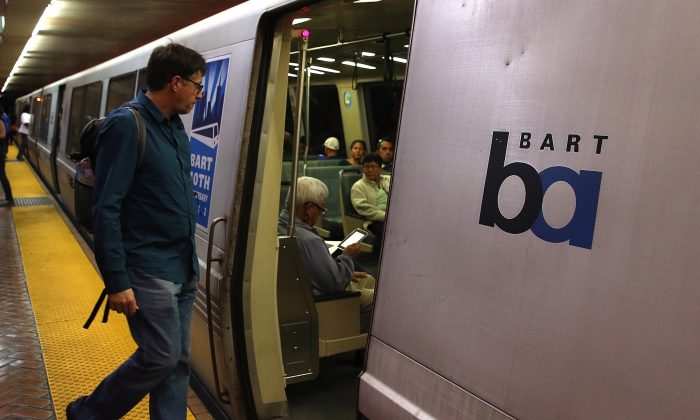 A Bay Area Rapid Transit (BART) passenger boards a train on October 15, 2013 in San Francisco, California. (Photo by Justin Sullivan/Getty Images)