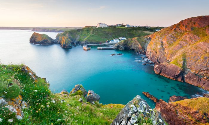 Sunset overlooking Mullion Cove Cornwall England UK via Shutterstock*