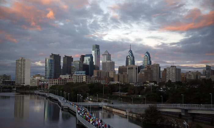 In this Oct. 1, 2014 file photo, runners jog along the Schuylkill Banks Boardwalk in Philadelphia. (Matt Slocum/AP Photo)