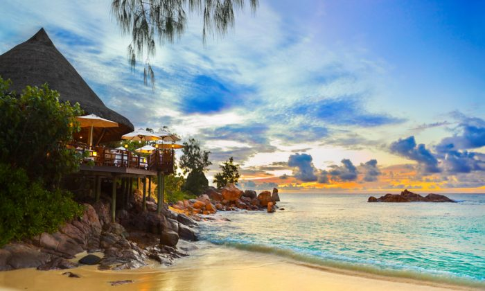 Cafe on tropical beach at sunset in Seychelles via Shutterstock*