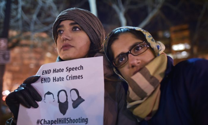 Women take part in a vigil for three young Muslims killed in Chapel Hill, North Carolina, at Dupont Circle on February 12, 2015 in Washington, DC. (Mandel Ngan/AFP/Getty Images)