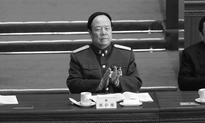 In this file photo, General Guo Boxiong, vice chairman of China's Central Military Commission, attends the opening session of the National People's Congress, on March 5, 2007 in Beijing, China. According to Apple Daily, Guo has been detained for interrogation in a corruption investigation. (Andrew Wong/Getty Images)