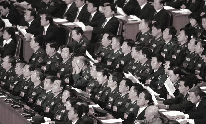Chinese Communists at 17th Party Congress inside the Great Hall of the People in Beijing October 21, 2007. Chinese communist officials rampantly faked their personal records in order to get better chances for bonuses and promotions. (Frederic J. Brown/AFP/Getty Images)
