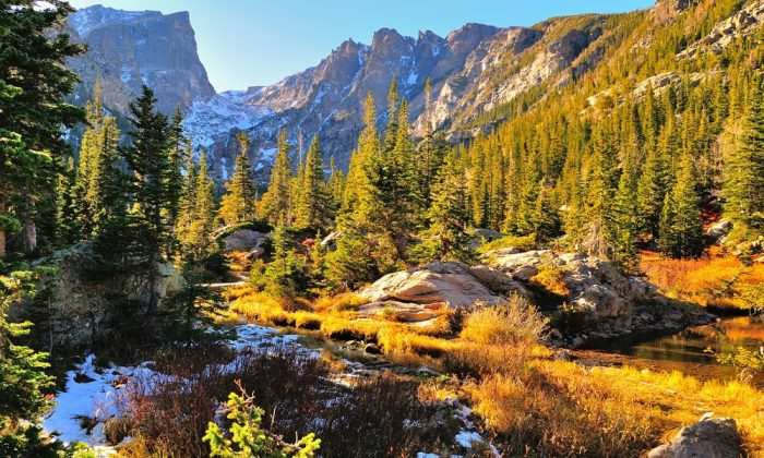 Rocky Mountain National Park in fall with snow and mountains in background, Colorado via Shutterstock*