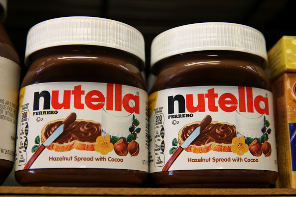 Jars of Nutella are displayed on a shelf at a market on August 18, 2014 in San Francisco, California.  The threat of a Nutella shortage is looming after a March frost in Turkey destroyed nearly 70 percent of the hazelnut crops, the main ingredient in the popular chocolate spread. Turkey is the largest producer of hazelnuts in the world.  (Photo by Justin Sullivan/Getty Images)