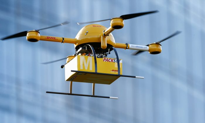 A quadcopter drone flies near Deutsche Post headquarters on December 9, 2013 in Bonn, Germany. It can carry human riders if they happen to weigh only a few ounces. (Andreas Rentz/Getty Images)