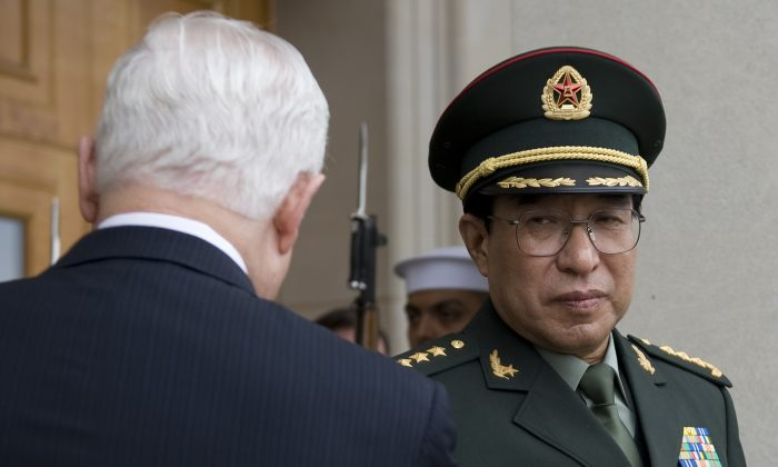 US Secretary of Defense Robert Gates (L) greets the People's Republic of China Central Military Commission Vice Chairman General Xu Caihou (R) at the Pentagon in Washington, DC, October 27, 2009. Xu, tried to move over 10 billion yuan in assets to Hong Kong, according to the Hong Kong newspaper Oriental Daily. (Jim Watson/AFP/Getty Images)