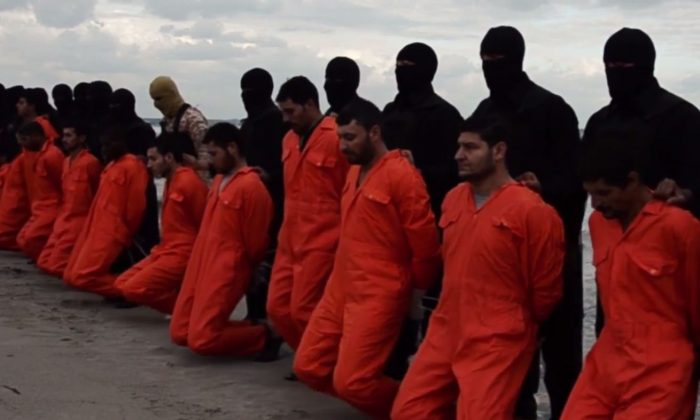 The Islamic State, or ISIS, has posted a video showing the apparent beheadings of 21 Egyptian Coptic Christians in Libya. (Screenshot from the ISIS video)