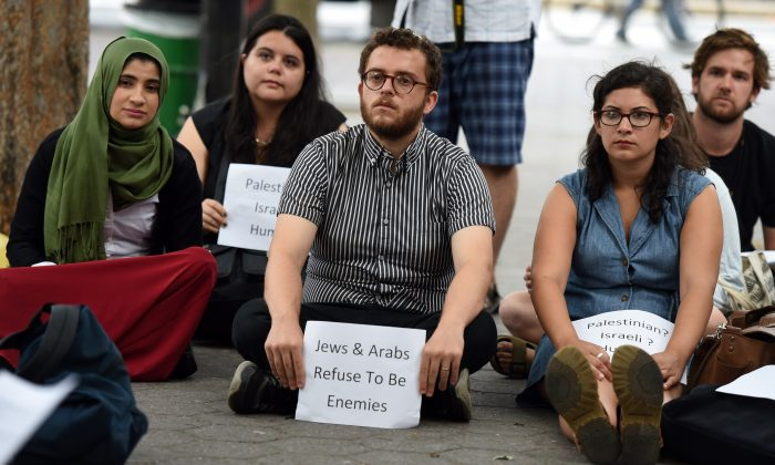 A candlelight vigil and silent protest organized as part of the #JewsAndArabsRefuseToBeEnemies movement near the United Nations in New York on Aug. 11, 2014. (Don Emmert/AFP/Getty Images)