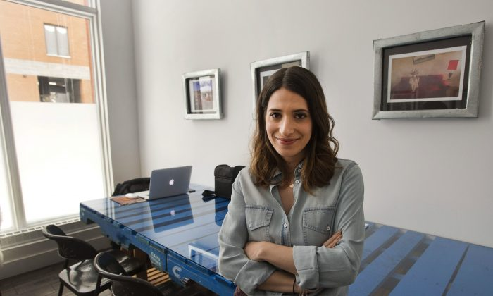 Sarah Lazar, a freelance graphic designer, in her rented office space in Montreal on Feb. 9, 2015. Breather, a mobile app that allows users to rent private workspace by the hour, hopes to capitalize on the steady movement of people into the ranks of the self employed or working from home. (The Canadian Press/Ryan Remiorz)