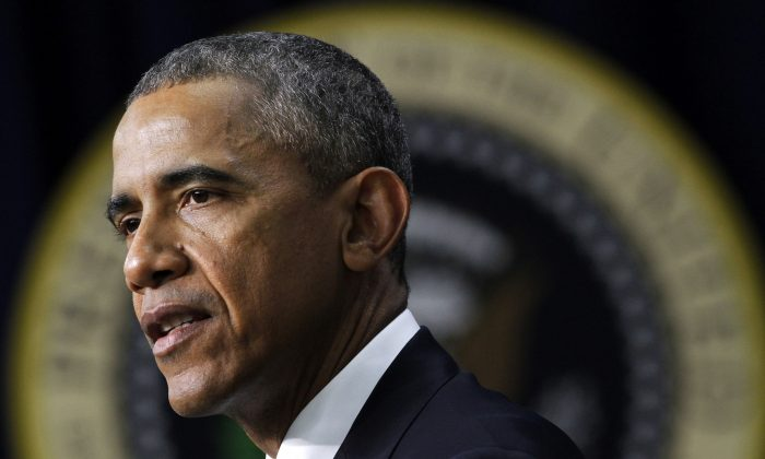 President Barack Obama speaks at the White House Summit on Countering Violent Extremism, Wednesday, Feb. 18, 2015, in the South Court Auditorium of the Eisenhower Executive Office Building in Washington, D.C. (AP Photo/Jacquelyn Martin)