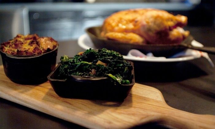 Chicken for Two With Savory Bread Pudding and Sweet and Sour Greens. (Courtesy of Almond Tribeca)