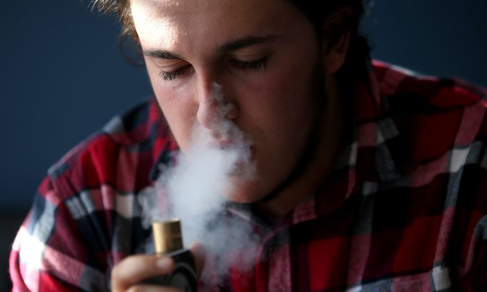 A man smokes an e-cigarette in San Rafael, Calif., on Jan. 28, 2015. A study with mice found that e-cigarette vapor made them  more susceptible to respiratory infections. (Justin Sullivan/Getty Images)