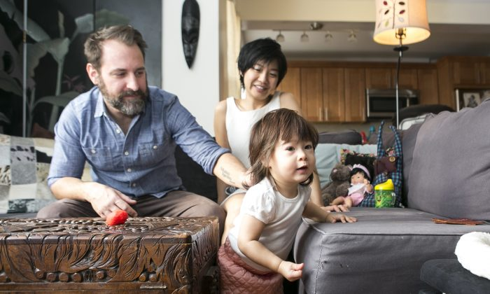 Musician Jeremy Wilms, his wife, actress Di Quon Wilms, and their 21-month-old daughter at their home in Forest Hills, Queens, on Thursday, Jan. 22, 2015. The former Brooklynites took their house hunting to three other states before resuming their search in New York City. (Samira Bouaou/Epoch Times)