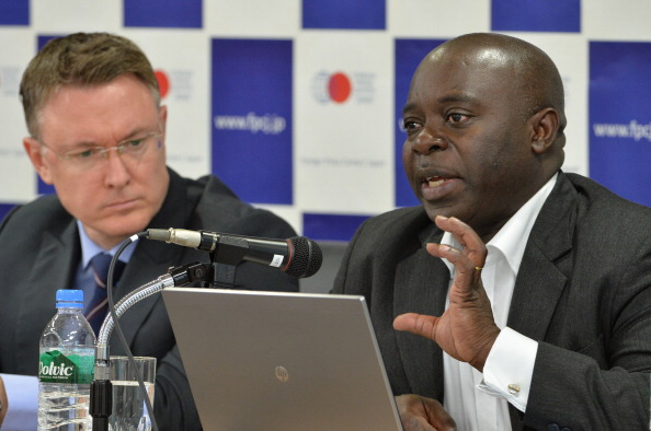 Justice Tettey (R), Chief of the Laboratory and Scientific Section, United Nations Office on Drugs and Crime (UNODC), speaks as Jeremy Douglas (L) of UNODC's Regional Office for Southeast Asia and the Pacific looks on during a press conference on May 20, 2014. Douglass has pointed out that Guangdong Province has become a center for the global supply of the synthetic drug meth. (Kazuhiro Nogi/AFP/Getty Images).
