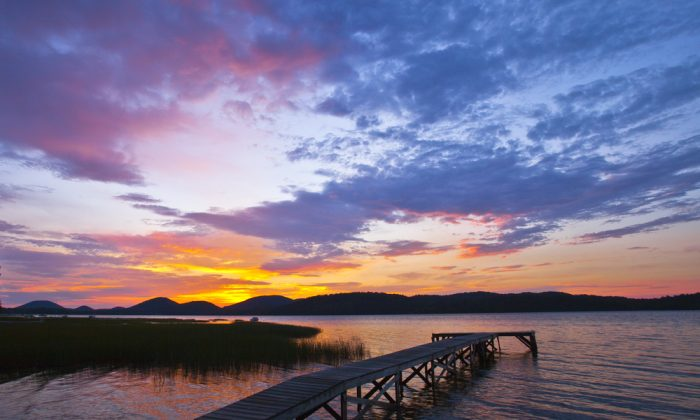 Adirondack Sunrise over a quiet lake via Shutterstock*