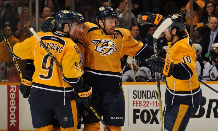 Filip Forsberg (L) and James Neal (R) of the Nashville Predators congratulate teammate Shea Weber on scoring a goal against the Winnipeg Jets during the first period of a game at Bridgestone Arena on February 12, 2015 in Nashville, Tennessee. (Frederick Breedon/Getty Images)