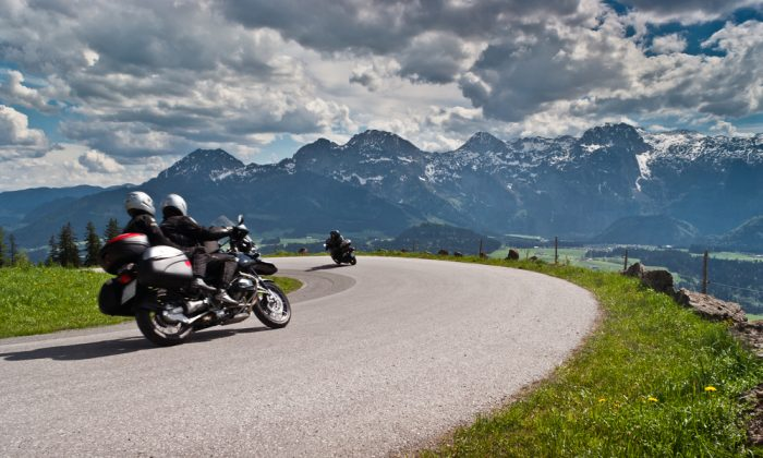 Motorbikes on the road in mountains with Alps in background.Salzkammergut,Austria via Shutterstock*