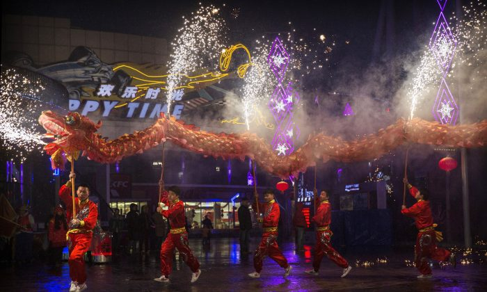 Chinese artists perform a dragon dance at a local amusement park during celebrations for the Lunar New Year February 19, 2015 in Beijing. Dozens of Chinese netizens raised a petition calling for the cancellation of CCTV's Chinese New Year Gala, condemning the performances' discriminatory and sexist content. (Kevin Frayer/Getty Images)