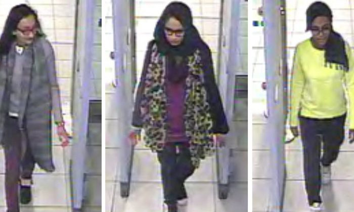 Kadiza Sultana, 16, left, Shamima Begum,15, centre and and 15-year-old Amira Abase going through security at Gatwick airport, before they caught their flight to Turkey. The three teenage girls left the country in a suspected bid to travel to Syria to join the Islamic State extremist group, Tuesday Feb 17, 2015. (AP/Metropolitan Police)