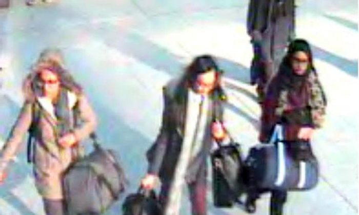 This is a still taken from CCTV issued by the Metropolitan Police in London on Monday Feb. 23, 2015,  of 15-year-old Amira Abase, left,  Kadiza Sultana,16, centre, and Shamima Begum, 15, going through Gatwick airport, south of London, before they caught their flight to Turkey on Tuesday Feb 17, 2015. (AP Photo/Metropolitan Police)