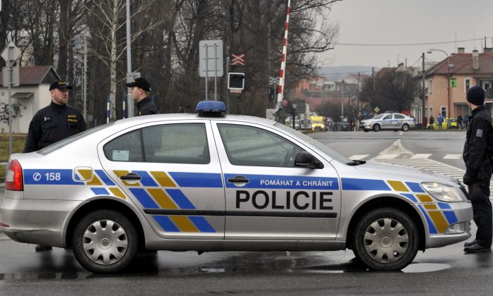 Police officers patrol near a restaurant where a gunman opened fire injuring at least one person in Uhersky Brod, in the east of the Czech Republic, Tuesday, Feb. 24, 2015. Police did not immediately release any details. (AP Photo/CKT, Dalibor Gluck) SLOVAKIA OUT
