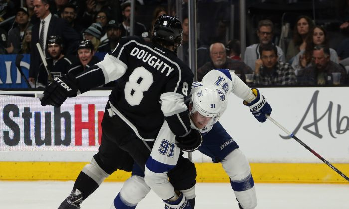 Drew Doughty holds up Steven Stamkos at the Staples Center on Feb. 16, 2015 in Los Angeles. The Kings defensemen shines in enhanced stats, but is less convinced of their usefulness. (Bruce Bennett/Getty Images)