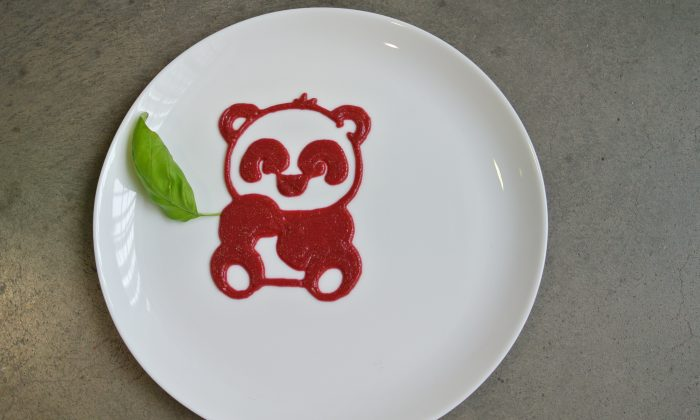 This undated photo provided by Natural Machines on Feb. 5, 2015 shows a plate decoration depicting a panda made by a food printer. Like more traditional 3-D printers, food printers work by printing out successive layers of edible material. (AP Photo/Natural Machines)