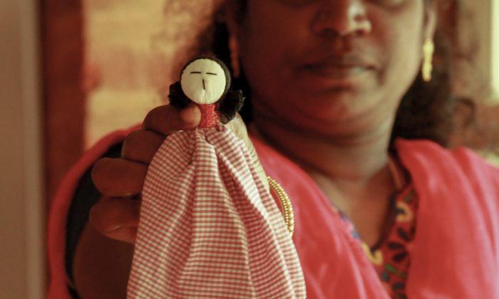A woman and her Tsunamika doll at the Upasana Integral Design studio in Auroville, India on Jan. 27, 2015. (Venus Upadhayaya/Epoch Times)