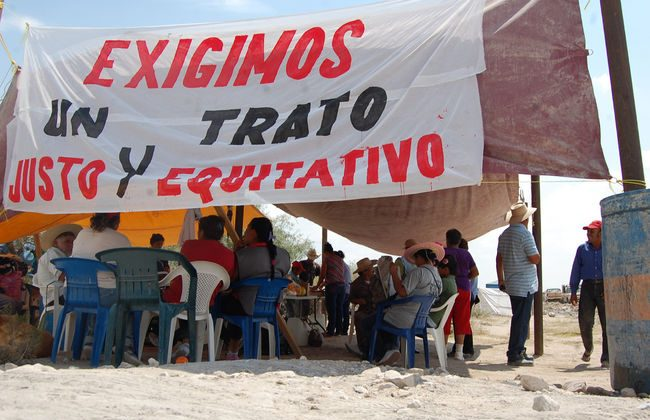 Ejido La Sierrita community members gather in the shade of a tent in the summer of 2012 during a protest outside Excellon Resources' La Platosa silver mine in Durango, Mexico. A new report says Canadian diplomats went too far in their attempts to protect Excellon's interests in a dispute with the Ejido La Sierrita. (Ejido La Sierrita)