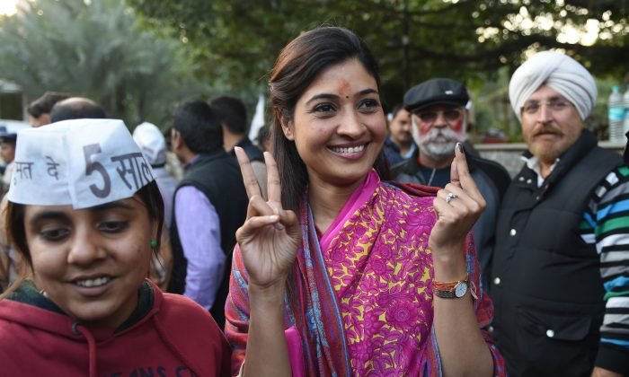 Senior leader of India's Aam Aadmi Party (AAP) Alka Lamba (C) gestures as she arrives for a meeting in New Delhi on Feb. 10, 2015. India's Narendra Modi suffered his first major election setback since becoming prime minister last May, as anti-corruption campaigner Arvind Kejriwal won a landslide victory in Delhi Territory polls. (Sajjad Hussain/AFP/Getty Images)