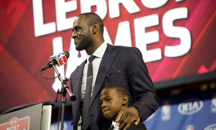 Miami Heat's LeBron James stands with his son, LeBron Jr., during an NBA basketball news conference, Sunday, May, 5, 2013, in Miami.. (AP Photo/J Pat Carter)