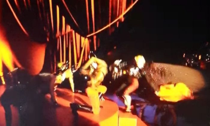 Madonna fell down on stage while she was performing at the Brit Awards. (Screenshot)
