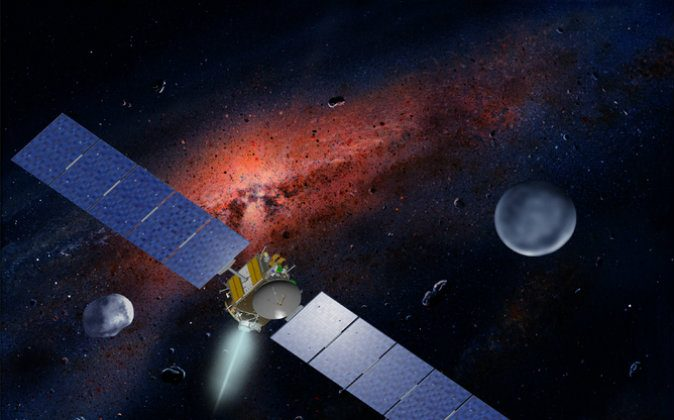 An artist's impression of the Dawn spacecraft traveling in the asteroid belt with its target Ceres on the right. JPL