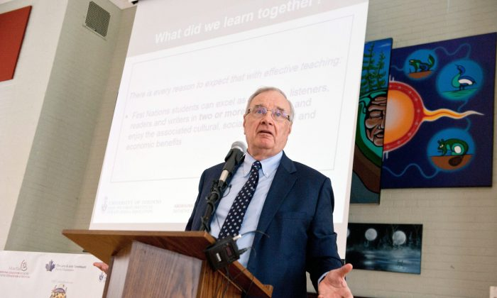 Former Canadian prime minister Paul Martin announces the results of a four-year project to improve students' achievement in literacy in two Ontario First Nations schools on Feb. 24, 2015 in Toronto. (The Canadian Press/Galit Rodan)