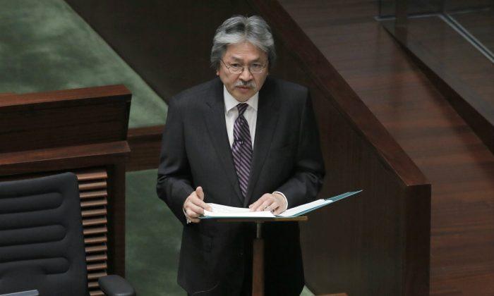 Hong Kong's Financial Secretary John Tsang delivers his annual budget speech at the Legislative Counci in Hong Kong on Feb. 25, 2015. (AP Photo/Vincent Yu)