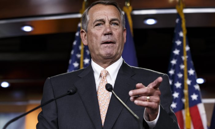 House Speaker John Boehner of Ohio responds to reporters about the problems in passing the Homeland Security budget because of Republican efforts to block President Barack Obama's executive actions on immigration, Feb. 26, 2015. (AP Photo/J. Scott Applewhite)