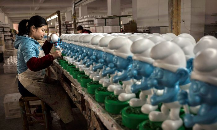 A Chinese worker paints ceramic Smurfs at a ceramics factory in Fujian Province, China, on Dec. 7, 2014. (Kevin Frayer/Getty Images)