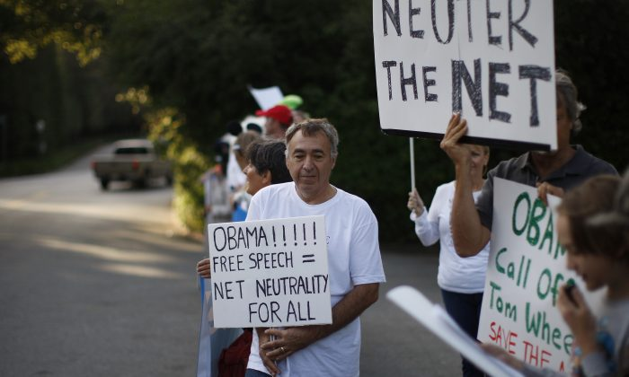 A man demonstrates for net neutrality in the exclusive neighborhood of Bel-Air outside a USC Shoah Foundation fundraiser to be attended by President Barack Obama on May 7, 2014 in Los Angeles, California. (David McNew/Getty Images)