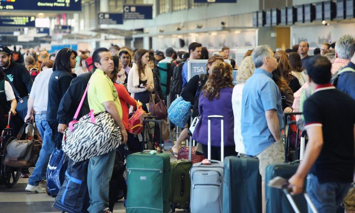 Passengers wait in line at a security checkpoint at Chicago's O'Hare Airport on May 23, 2014. (Scott Olson/Getty Images)