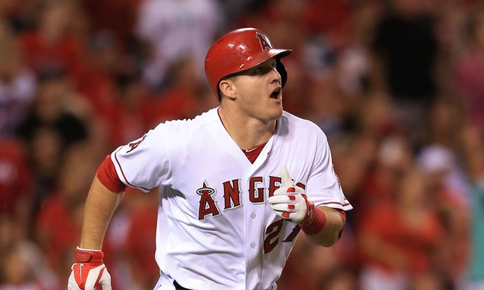 Mike Trout of the Los Angeles Angels of Anaheim watches his hit for a triple go to the right center field in the fifth inning during the MLB game against the Texas Rangers at Angel Stadium of Anaheim on September 20, 2014. (Victor Decolongon/Getty Images)