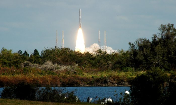 Launch of New Horizons, the mission to Pluto, atop the mighty Atlas V rocket from Cape Canaveral Air Force Station, Fla., on Jan. 19, 2006. (NASA Kennedy)