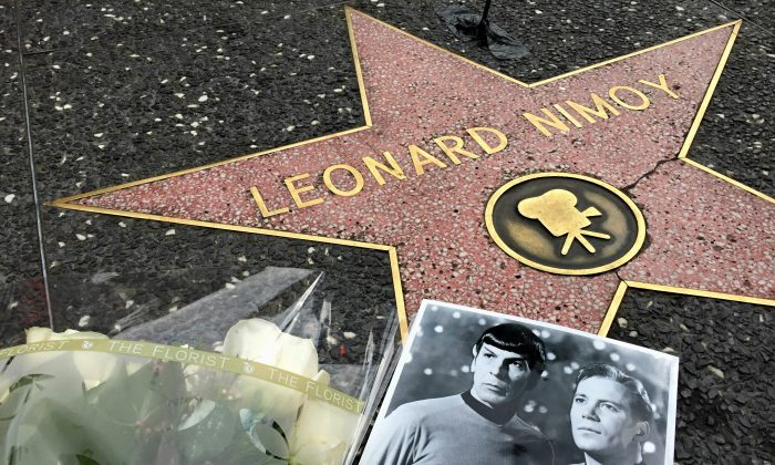"Flowers adorn the Hollywood Walk of Fame star of Leonard Nimoy in Los Angeles Friday, Feb. 27, 2015. Nimoy, famous for playing officer Mr. Spock in ""Star Trek"" died Friday, Feb. 27, 2015 in Los Angeles of end-stage chronic obstructive pulmonary disease. He was 83. (AP Photo/Damian Dovarganes)"