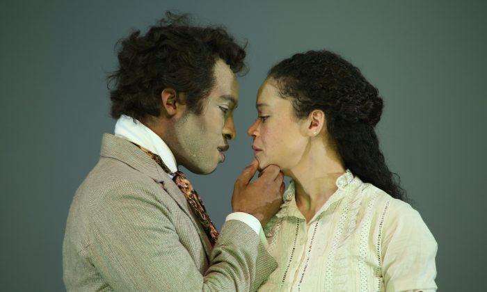 """George (Austin Smith in white face), nephew to a deceased plantation owner, falls for Zoe (Amber Gray), a beautiful ex-slave, in a reworking of """"An Octoroon.""""  (Gerry Goodstein)"""