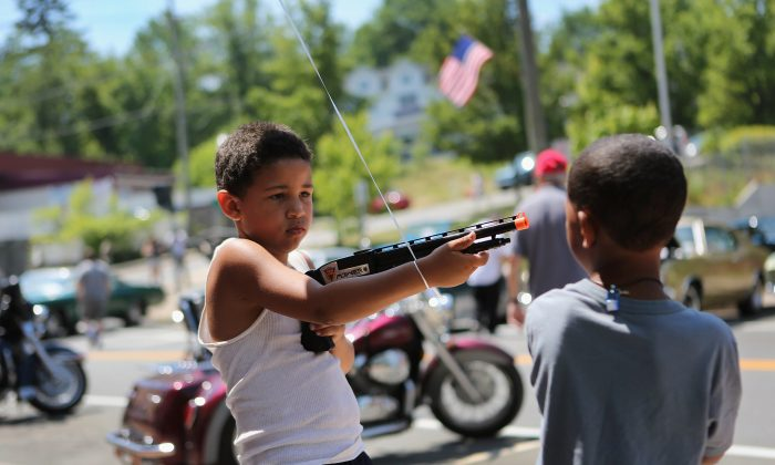 Children play with a toy gun during Fourth of July celebrations in Liberty, N.Y., in 2012. (John Moore/Getty Images)