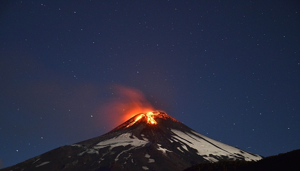 Picture of the Villarrica volcano, located near Villarrica 1200 km from Santiago, in southern Chile, which began erupting on March 3, 2015. (ARIEL MARINKOVIC/AFP/Getty Images)