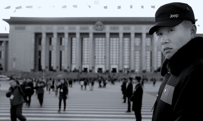 A plainclothes policeman guards outside Great Hall of the People after the opening session of the Chinese People's Political Consultative Conference (CPPCC) in Beijing on March 3, 2015. (Lintao Zhang/Getty Images)