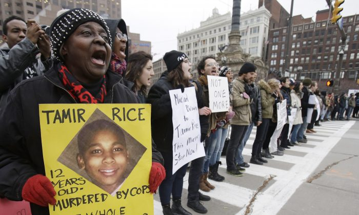 Demonstrators block Public Square in Cleveland on Nov. 25, 2014 during a protest over the shooting of 12-year-old Tamir Rice. (AP Photo/Tony Dejak)