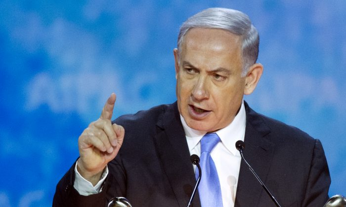 Israeli Prime Minister Benjamin Netanyahu gestures while addressing the 2015 American Israel Public Affairs Committee (AIPAC) Policy Conference in Washington, March 2, 2015. (AP Photo/Cliff Owen)